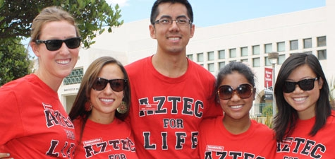 students wearing Aztec for Life tees